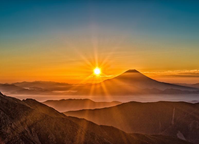 sun over mountain landscape