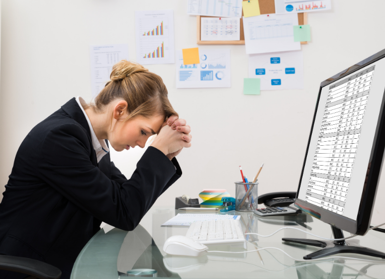 woman frustrated with spreadsheets