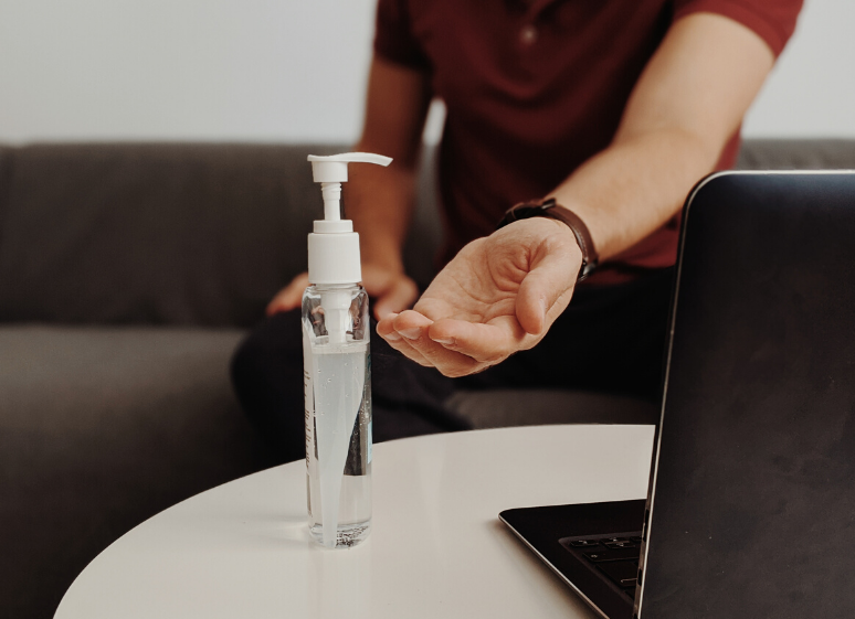 hand sanitizer and computer