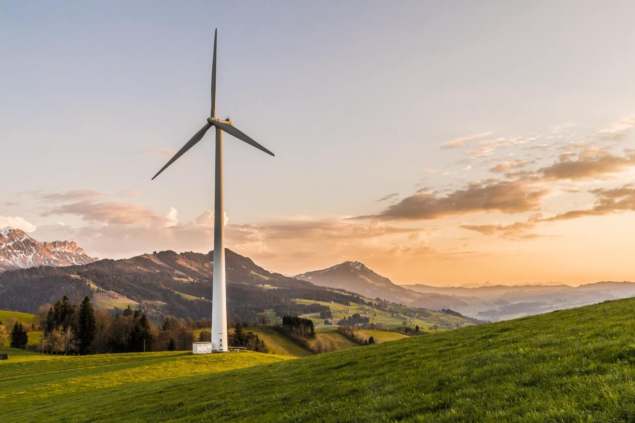 sustainability white windmill on hillside